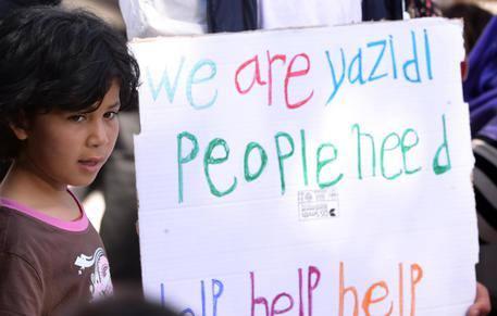 """""""We are Yazidi people, Need Help Help Help"""" (ANS/AFP/FILIPPO MONTEFORTE/POOL)"""